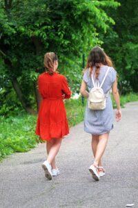 Girls walking along a footpath